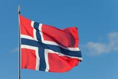 Norwegian flag. The norwegian national flag waving in the sun Stock Photo