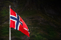 Norwegian flag bevore mountains. Norwegian flag in front of mountains Stock Image