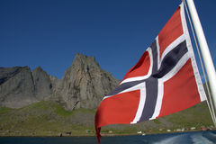 Norwegian flag and fjord royalty free stock photography
