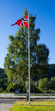 Norwegian flag on a flagpole Royalty Free Stock Photo