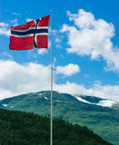 Norwegian flag in front of mountains Royalty Free Stock Photos