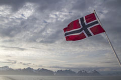 Norwegian flag. And Lofoten mountains with sea Stock Images