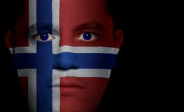 Norwegian Flag - Male Face. Norwegian flag painted/projected onto a man's face Stock Images
