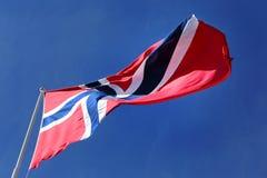 Norwegian flag. Norwegian national flag hoisted on blue sky Stock Image