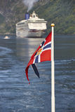Norwegian flag. Norway fjord landscape with cruise. Travel backg Stock Image