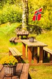 Norwegian flag and green picnic site Stock Photos