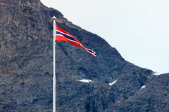 Norwegian flag in rocky mountains Stock Images