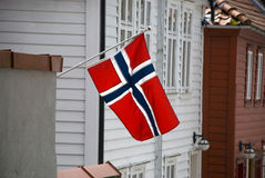 Norwegian flag and scandinavian houses Royalty Free Stock Photography