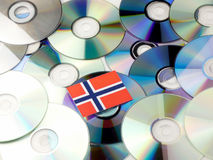 Norwegian flag on top of CD and DVD pile isolated on white. Norwegian flag on top of CD and DVD pile isolated Stock Photos