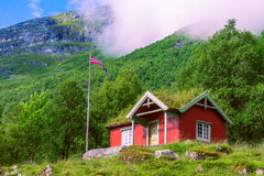 Norwegian flag and typical house in valley Innerdalen Stock Photo