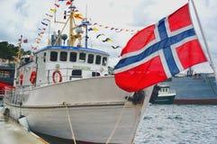Norwegian flag waving on the ship Stock Photos
