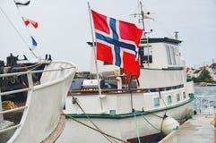 Norwegian flag waving on the ship Stock Photo