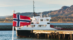 Norwegian flag waving on ship railings Stock Photo