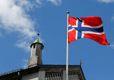 Norwegian flag. In wind with sky background Royalty Free Stock Image