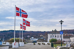 Norwegian flags on masts. Royalty Free Stock Photo