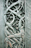 Norwegian folk art. Ancient norwegian carvings with scenes from Norse mythology. This pattern decorates the old stave church of Urnes in the western fjords of Stock Photos