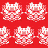 Norwegian folk art seamless white pattern on red background Royalty Free Stock Image