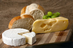 Norwegian and french cheese on cutting board Royalty Free Stock Photo