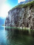 Norwegian Geiranger Fjord Waterfall coming down a rock royalty free stock images