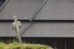 Norwegian graveyard and stave church roof. Fantoft. Bergen. Norw Royalty Free Stock Image