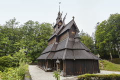 Norwegian graveyard and stave church roof. Fantoft. Bergen. Norw. Norwegian graveyard and stave church roof. Fantoft. Bergen. Visit Norway Royalty Free Stock Image