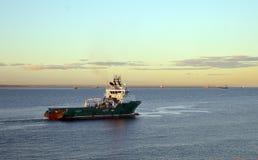 Norwegian Havila Neptune oil rig supply vessel leaves Aberdeen. ABERDEEN, SCOTLAND - 21 OCTOBER 2015: In evening sunshine, the Norwegian-registered Havila Royalty Free Stock Image
