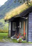 Norwegian house facade with grass roof. A characteristic Norwegian house, made of wood, with the roof covered with grass royalty free stock photo