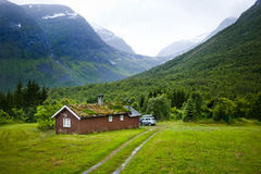 Norwegian house and mountains Royalty Free Stock Image