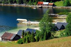 Norwegian houses by the beach Royalty Free Stock Images