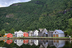 Norwegian houses reflecting in the water in Laerdal, Norway. Norwegian houses reflecting in the water on the shore of Sognefjord at Laerdal, Norway Stock Images