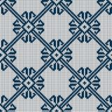 Norwegian knitted blue pattern on a white background. Woolen seamless knitted pattern Royalty Free Stock Photography