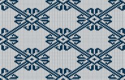 Norwegian knitted blue pattern on a white background. Woolen seamless knitted pattern Royalty Free Stock Images