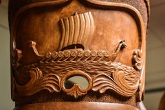 Norwegian Kubbestol Carving of a Ship Stock Photo