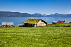 Norwegian landscape. The Norwegian fishing small houses on the bank of lake Stock Images