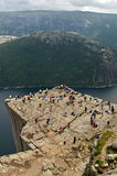 Norwegian landscape. A beautiful rock overhanging the fjord, Preikestolen, Lysefjord, Norway Royalty Free Stock Photo