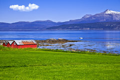 Norwegian landscape. The Norwegian fishing small houses on the bank of lake Royalty Free Stock Photography