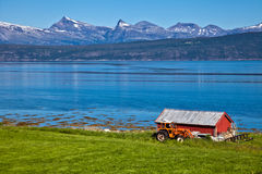 Norwegian landscape. The Norwegian fishing small houses on the bank of lake Royalty Free Stock Image