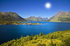 Norwegian landscape. Fishing small house on the bank of mountain lake Stock Photo