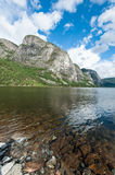 Norwegian landscape. A mountain beside a lake in Norway Royalty Free Stock Photos