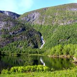 Norwegian landscape. Landscape in Eikesdalen norway with waterfall in the background, mountain and lake Royalty Free Stock Photos