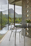Norwegian landscape indoor viewpoint with table and chair. Norwa Stock Images
