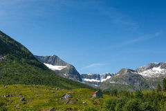 Norwegian landscape with mountains covered by snow Royalty Free Stock Photo
