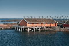 Norwegian landscape, red wooden houses. Norwegian landscape, traditional red wooden houses on rocky islands. Ringholmen, Norway Stock Images