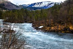 The norwegian landscape: river, forest and mountain Royalty Free Stock Photography