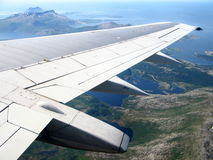 Norwegian landscape under aeroplane wing Stock Images