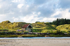 Norwegian landscape with small house Stock Photos