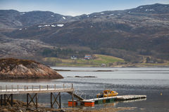 Norwegian landscape. Small motor boat Royalty Free Stock Photos