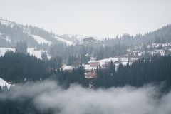 Norwegian landscape with typical scandinavian houses in mountains and forest covered with snow. Winter Scene. stock photo