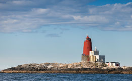 Norwegian Lighthouse with Large Red Tower Royalty Free Stock Photos