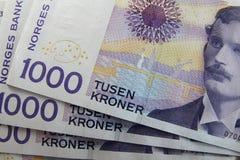 Norwegian money. Norwegian kronas on a table forming texture stock photos